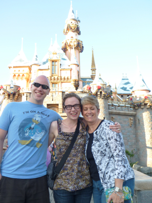 Casey, Jessica, and Anniekay in front of the Disney Castle